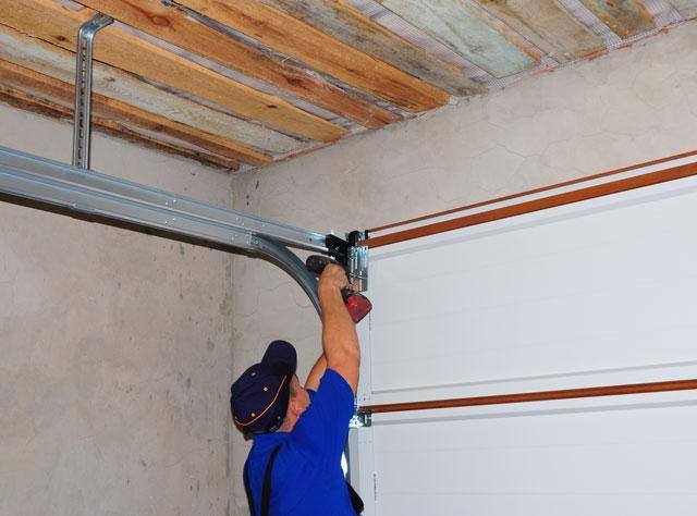 Leave The Garage Door Repair To The Professionals Sure Fix Garage Door