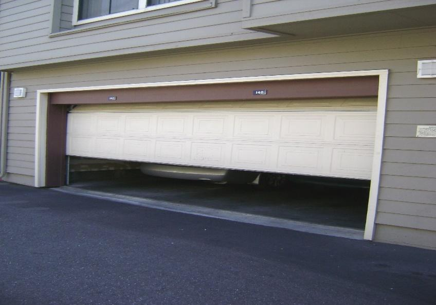 the garage door reverse before hitting the ground