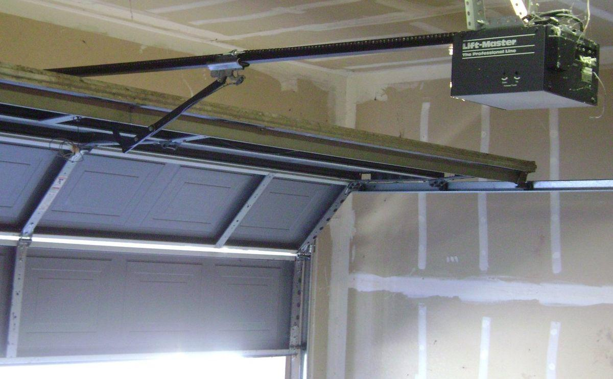 how to quiet down a loud garage door opener