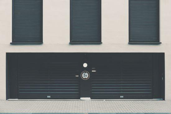 Two black sturdy steel garage doors