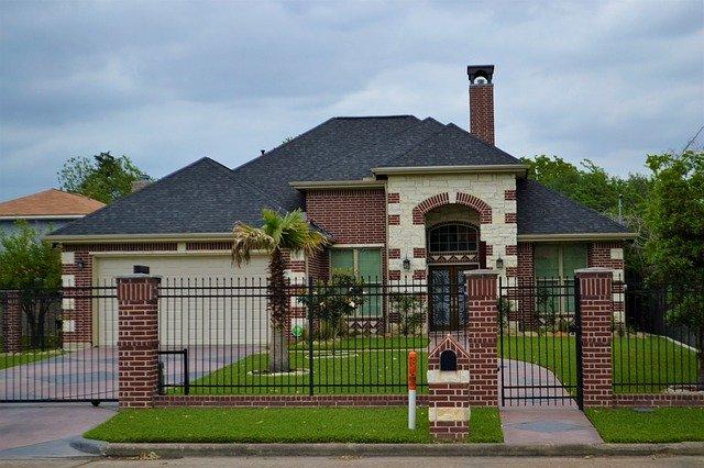 Gated home with nice looking garage door