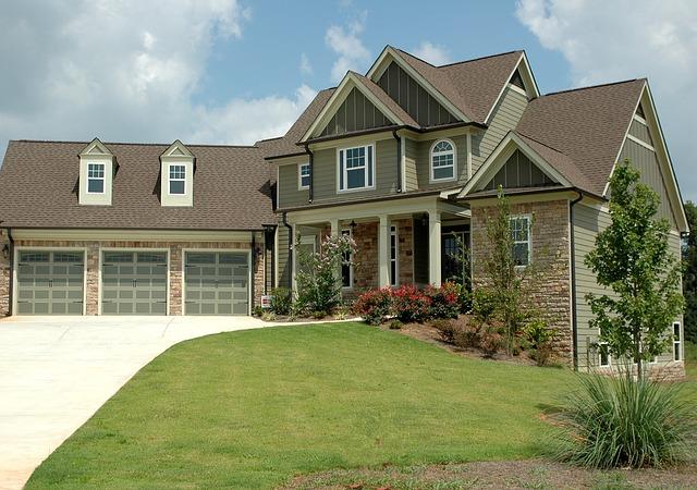 new-home with three garage doors