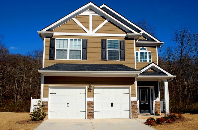 Two white Garage Door Installation Countryside Pines