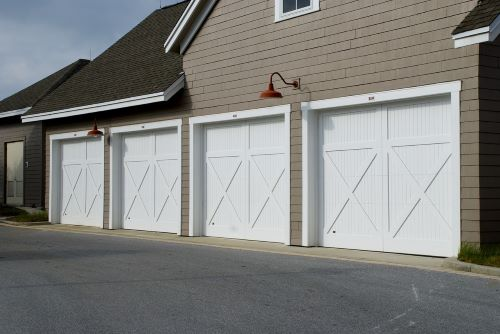 four white garage door installation in Clearwater, FL